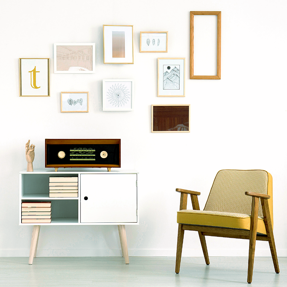 Gallery wall with chair
